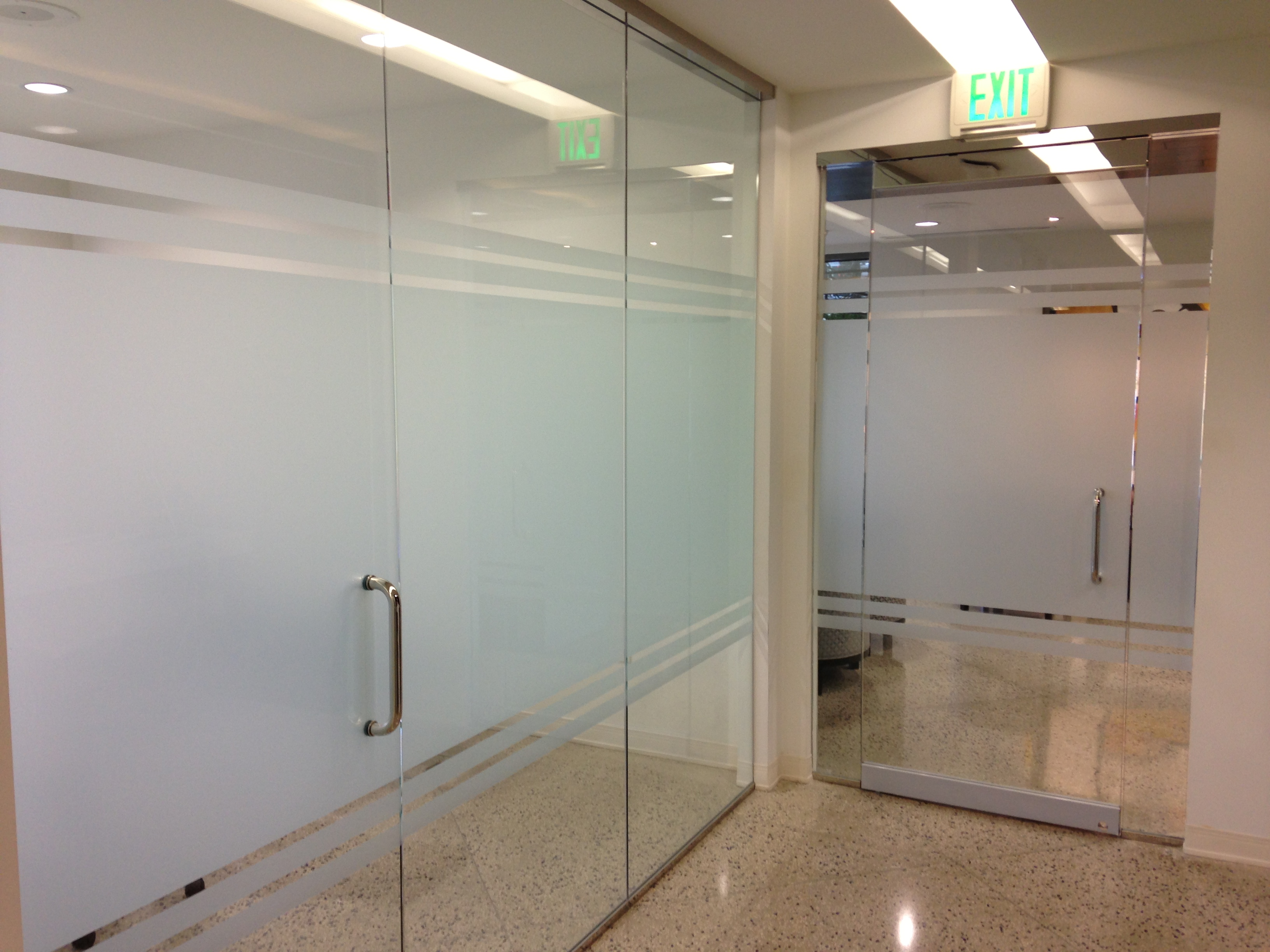 Frost window film gives contemporary look to offices in for Window manufacturers dallas