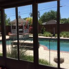 Residential window tinting improves a sunroom in Frisco, TX
